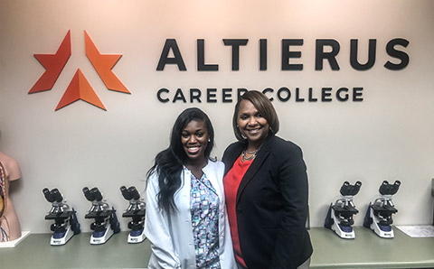A Student and Faculty Member Smile in a Classroom at Altierus Career College Near Atlanta